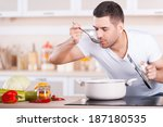 tasting soup. handsome young... | Shutterstock . vector #187180535