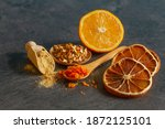Small photo of Dehydrated orange peel rind, powder and fresh orange zest on a table.