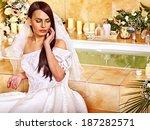 woman wearing wedding dress at...   Shutterstock . vector #187282571