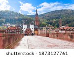 The Alte Brucke (old bridge), is an arch bridge in Heidelberg that crosses the Neckar river.