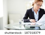 Young Businesswoman Sitting At...