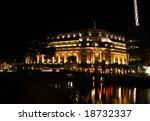 Fullerton hotel at night in Singapore