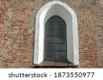 Arched Window With Bars In The...