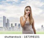beautiful young woman looking... | Shutterstock . vector #187398101