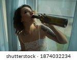 drunk woman in depression is in ... | Shutterstock . vector #1874032234