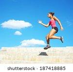 sporty mixed race woman jumping.... | Shutterstock . vector #187418885