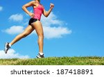 sporty mixed race woman jogging.... | Shutterstock . vector #187418891