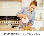Young Woman Uses Mixer In...