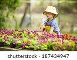 little girl in the garden | Shutterstock . vector #187434947