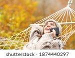 Happy Woman Lying On Hammock...