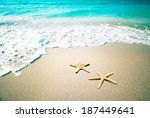 starfish on a beach sand.... | Shutterstock . vector #187449641