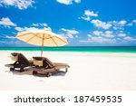 two beach chairs and umbrella... | Shutterstock . vector #187459535