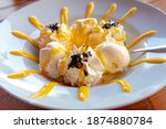 Dame blanche is the name used in Belgium and the Netherlands for a sweet dessert consisting of vanilla ice cream with whipped cream and warm molten chocolate, Dessert is similar to the American sundae
