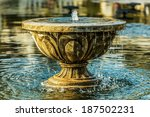 Antique Stone Fountain In A Pond
