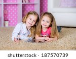 little kids playing on a tablet ... | Shutterstock . vector #187570739