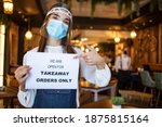 Barista Holding  Sign We Re...