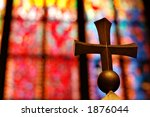 Gold cross and colorful stained glass window - stock photo