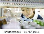 boy choosing drink at... | Shutterstock . vector #187641011
