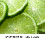 close-up of several slices of green lemon fruit - stock photo