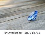 blue gemstone on wood.   Shutterstock . vector #187715711