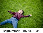 Child Boy Lying On The Green...