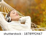 Relaxed Woman Listening To...