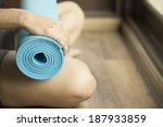 young woman holding a yoga mat | Shutterstock . vector #187933859