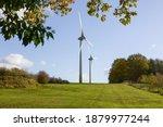 Wind Turbines In A Field Near A ...
