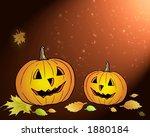 two pumpkins in yellow leafs   Shutterstock . vector #1880184