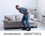 Small photo of Black Man Having Stomachache Suffering From Painful Abdominal Spasm Standing Touching Aching Abdomen At Home. Abdomen Pain, Stomach Inflammation And Appendicitis Concept