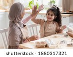 Family Teamwork. Happy Muslim...