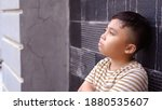 the boy is thinking and leaning ... | Shutterstock . vector #1880535607