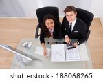 business colleagues calculating ... | Shutterstock . vector #188068265