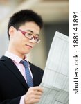 a young businessman reading... | Shutterstock . vector #188141891
