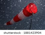Red And White Windsock Against...