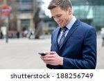 attractive businessman using... | Shutterstock . vector #188256749