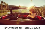 young couple in a convertible... | Shutterstock . vector #188281235