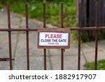 A Please Close The Gate Sign...