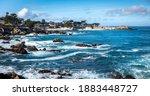 Waves Splash On The Rocky Coast ...