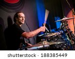 musician playing drums on stage, rock music concert - stock photo
