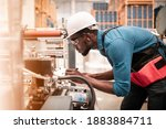 Small photo of Technician working in factory check functionality while commissioning a production line, Man working