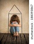 Stock photo sad child sitting on the floor homeless kid in dark room 188393867