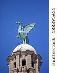 a liver bird statue perched...