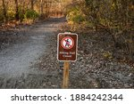 A Hiking Trail Closed Sign In...