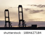 Silhouette Of Container Cranes...