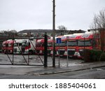 Red And White Wagons Parked In...