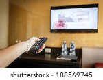 hand holding television remote... | Shutterstock . vector #188569745