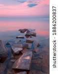 Small photo of Beautiful sunset landscape with sea gangway stones. Long exposure shot.