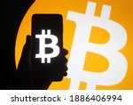 Bitcoin Sign On A Screen Of...