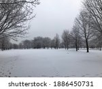 Snow Covered Open Park Area...